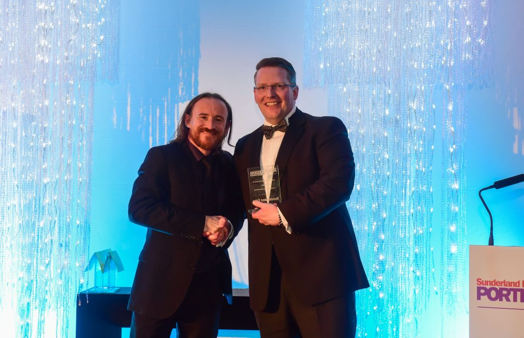 Ben Crompton (left) of Game of Thrones presenting the Creative Industries Award to Paul Finch of Pulse Creative Marketing